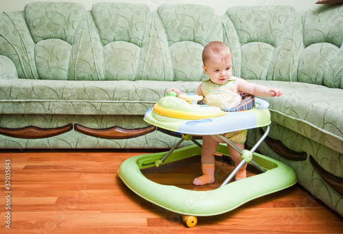 Photo  baby in the baby walker