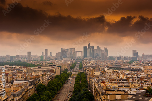 image with dramatic clouds over the Champs Elysees in Paris