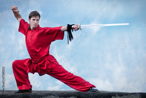 Wushoo man in red practice martial art Poster