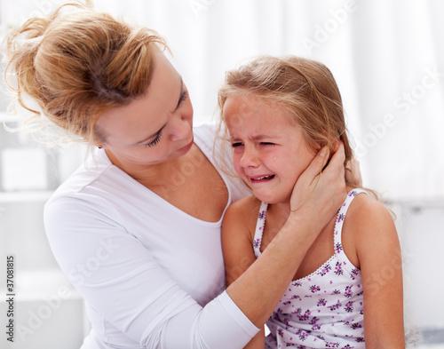 Mother comforting her crying little girl Fototapeta