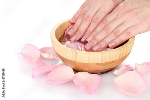 Poster Pedicure Beautiful female hands and rose petals