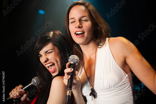 Photo  Female singers performing