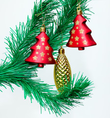 Branch of Christmas tree with colorful bauble hanging