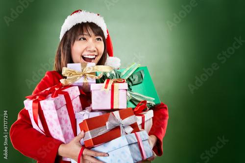 Fotografie, Obraz  Christmas girl carrying presents