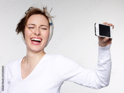 Photo  Laughing girl takes a self-photograph with smart phone