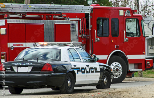 Police car and fire truck on scene Poster Mural XXL