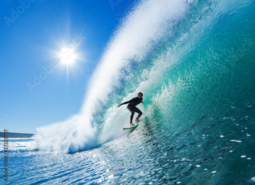 Fototapeta na wymiar Surfer on Blue Ocean Wave