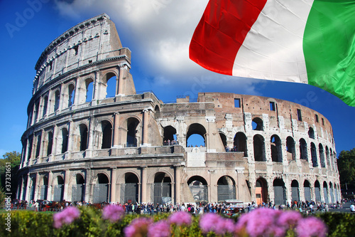 Photo  Colosseum with flag of Italy , Rome