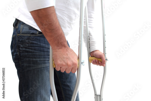 walking with crutches Fotobehang