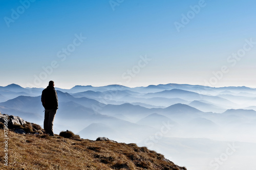Misty mountain hills and man silhouette Poster