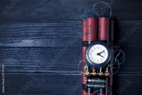Photo  Dynamite time bomb on a blue texture background