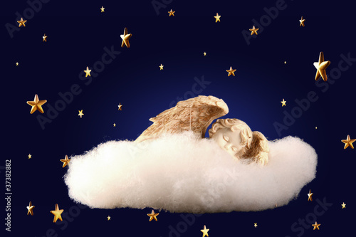 Photo cherub sleeping on a cloud among the stars