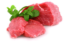 Cut Of  Beef Steak With Green ...