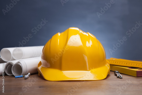 Fototapeta Construction plans and blueprints on wooden table obraz na płótnie