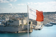 Maltese Flag Is Flying From Up...