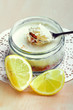 Lemon cheesecake in glass jar, closeup shot