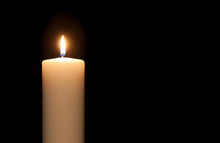 White Candle Isolated Against ...