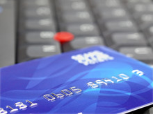 Closeup Of Credit Card On Computer Keyboard