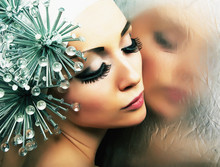 Beautiful Glamorous Young Girl With Nails Reflects In Mirror