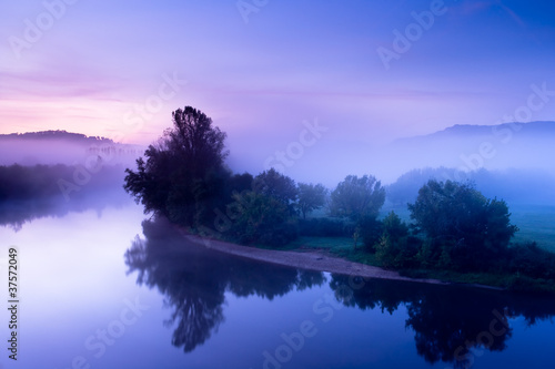 The Dordogne misty river at sunrise
