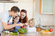 Family preparing salad together