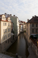 Fototapeta na wymiar old houses alonf prague canal