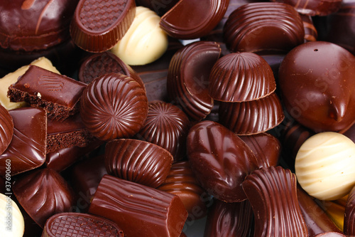 Photo Stands South America Country Many different chocolate candy closeup