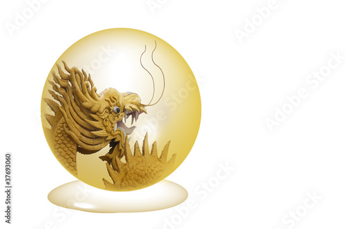 Photo  Golden Dragon in crystal ball isolated on a white background.