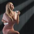 Leinwanddruck Bild blond sensual lady with a cup coffee