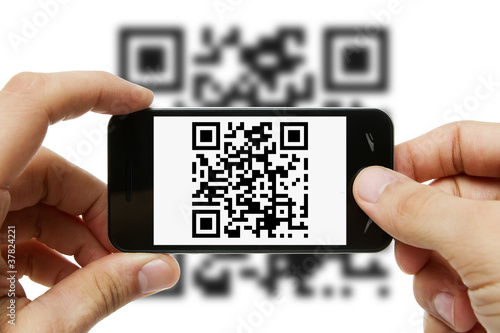 Fotografie, Obraz  Scanning QR code with mobile phone
