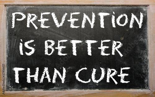Cuadros en Lienzo Proverb Prevention is better than cure written on a blackboard