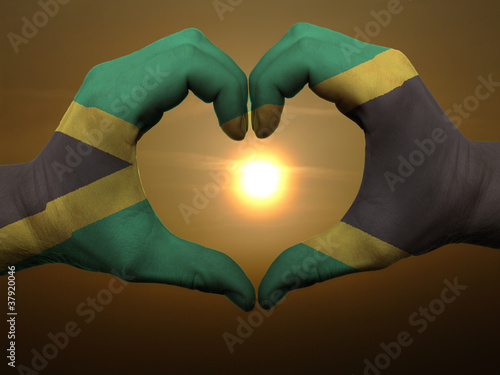 Foto  Heart and love gesture by hands colored in jamaica flag during b