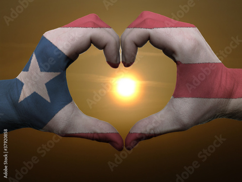 Poster Algérie Heart and love gesture by hands colored in puertorico flag durin