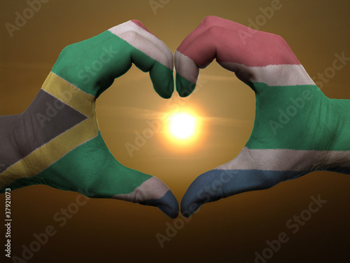 Poster Algérie Heart and love gesture by hands colored in south africa flag dur