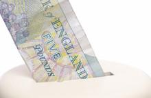 Five Pound Note & Piggy Bank.