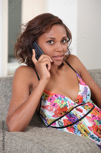 Fotografija  gorgeous mixed-race lady making a call