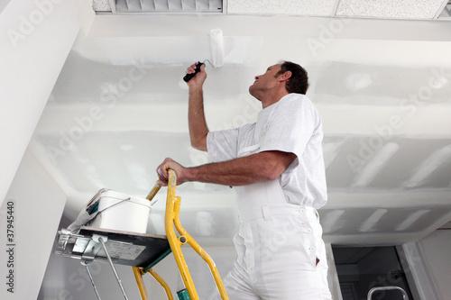 Obraz na plátne Tradesman painting a ceiling