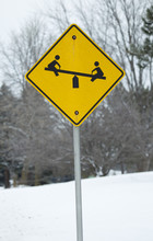 Yellow Child On Teeter Totter Sign