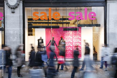 Sale signs in shop window #37965600