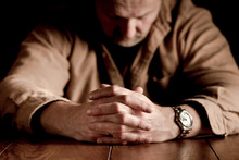 Clasped Hands On Troubled Man