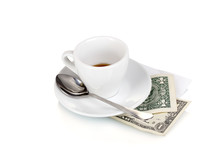 Empty Cup Of Coffee With Two Dollars Tip Isolated On White