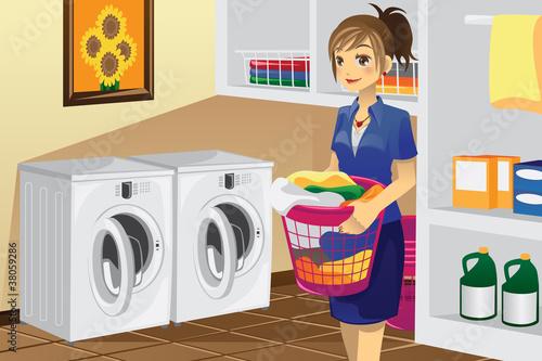 Fotografie, Obraz  Housewife doing laundry