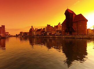 Sunset cityscape with vibrant colors. Gdansk, Poland.