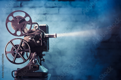 Poster Retro old film projector with dramatic lighting