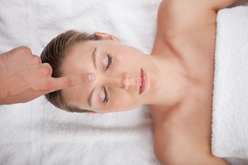 Fototapeta na wymiar Massaging female face at the spa