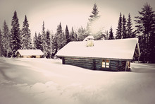 Vintage Log Cabin In Snow