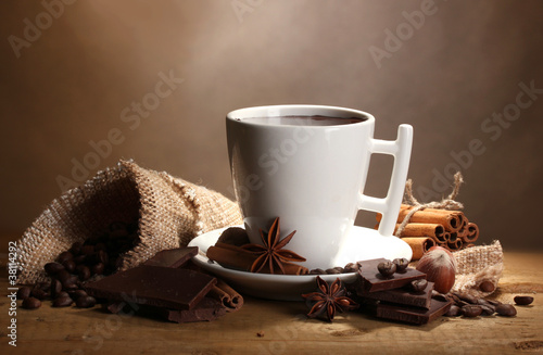 Papiers peints Chocolat cup of hot chocolate, cinnamon sticks, nuts and chocolate