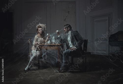 Nowoczesny obraz na płótnie Young couple drinking coffee in an old castle