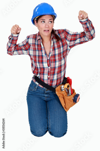 craftswoman kneeling and clenching her fists