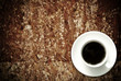 Coffee cup on grunge wood table